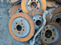 Useless worn out rusty brake discs and other parts Royalty Free Stock Photography