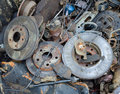 Useless worn out rusty brake discs shock absorber and other parts Royalty Free Stock Photo