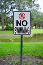 Usf campus landscape no swimming sign taken in tampa Royalty Free Stock Photo