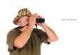 Using binoculars hunter to search for game isolated on white with copy space in front of the hunter Royalty Free Stock Photography