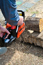 Using a chainsaw Royalty Free Stock Photo
