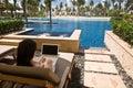 Using computer at hotel lagoon room Royalty Free Stock Photo