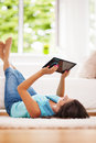 Using digital tablet woman at home Royalty Free Stock Images