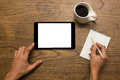 Using a digital tablet and writing notes with coff male hands cup of coffee Stock Photography