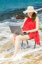 Using laptop on beach beautiful woman Royalty Free Stock Photo
