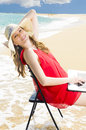 Using laptop on beach beautiful woman Royalty Free Stock Photography
