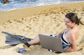 Using laptop on beach beautiful woman Stock Photos