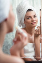Using lip balm young woman is after bath Stock Images