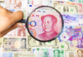 Using a magnifier to search the method of asian market financial concept Stock Images