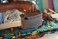 Using an old iron in West Africa Stock Photography