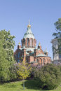 Uspenski cathedral in helsinki with purple and white flowering t Royalty Free Stock Photo
