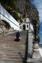 Uspensky monastery in bakhchisaray the monk going upstairs crimea Royalty Free Stock Photo