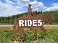 Utah horse rides image of a sign advertising made out of steel with mountains in the background Royalty Free Stock Image