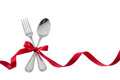Utensils Fork Spoon with Red Ribbon isolated on white Royalty Free Stock Photo