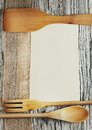 Utensils sheet of paper and ribbon on the old wooden background Stock Images