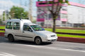 Utility car small on the road travelling in high speeds Royalty Free Stock Photos