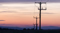 Utility poles with sunset sky background Royalty Free Stock Images