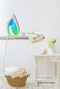 Utility room in the home with iron and basket of freshly laundered washing Stock Photography