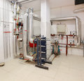 Utility room in house basement withboilers and pipes Royalty Free Stock Image