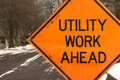 Utility work ahead road construction warning sign on a winter road in a residential neighborhood Stock Photography