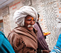 Uttar pradesh elderly indian man walking in the crowd temple yard ayodhya india is th largest state with Stock Photos
