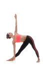 Utthita trikonasana extended triangle pose sporty yoga girl on white background in Royalty Free Stock Image