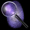 Uv lit fingerprint under a magnifying glass d rendering isolated on dark black background Royalty Free Stock Image
