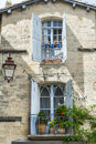 Uzes france gard languedoc roussillon old typical house with flowers Royalty Free Stock Image