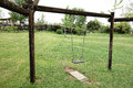 Vacant hanging swing photo of a in the garden Royalty Free Stock Photography