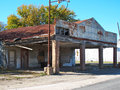 Vacant service station located in a small texas town Stock Photo