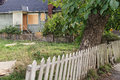 Vacant unkept yard with rickety fence and boarded up house Royalty Free Stock Photo