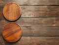 Vacant wooden pizza plates free space vertical Royalty Free Stock Photo