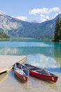 Vacation concept with canoes on emerald lake in yoho national park british columbia canada Stock Image