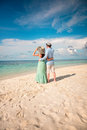 Vacation couple walking on tropical beach maldives a man and women romantic walk the Royalty Free Stock Images