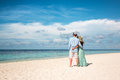 Vacation couple walking on tropical beach maldives a man and women romantic walk the Stock Photography