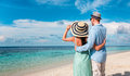 Vacation couple walking on tropical beach maldives a man and women romantic walk the Royalty Free Stock Photo