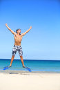 Vacation happy beach man jumping with snorkeling fins and mash excited about summer holidays travel on tropical fit male Royalty Free Stock Image