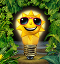 Vacation ideas and holiday planning solutions with a happy sun character in a shinning glowing light bulb in a night time tropical Stock Photo