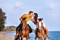 Vacation lifestyles couple horseback riding at sunset Stock Images