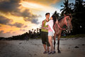 Vacation lifestyles couple horseback riding at sunset Royalty Free Stock Photography