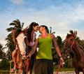 Vacation lifestyles couple horseback riding at sunset Royalty Free Stock Photo