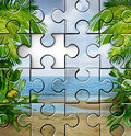 Vacation planning and finding travel tips as an incomplete jigsaw puzzle with a tropical summer beach scene for a fun family Royalty Free Stock Image