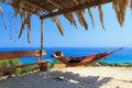 Vacation relaxing young man in a hammock on the island of zakynthos greece Stock Photo