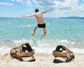 Vacation sea jump holiday concept man jumping into the torquoise tropic at Stock Images