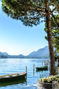 Vacation summer serene Lugano lake surrounded by hills in Morcote Royalty Free Stock Photo