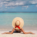 Vacation woman in big sun hat tanning and relaxing on tropical beach Stock Images