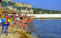 Vacationers relaxing on balchik beach the of bulgarian town Royalty Free Stock Photography