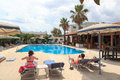 Vacationers relaxing at the hotel swimming pool in rhodes greece Stock Photography