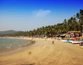 Vacationers, sellers, cafe on the tropical beach Palolem, on January 31, 2014 in Goa, India Royalty Free Stock Photos