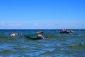 Vacationers swim on air mattresses on shoal in the baltic sea kulikovo russia — july kulikovo kaliningrad region russia Royalty Free Stock Photo